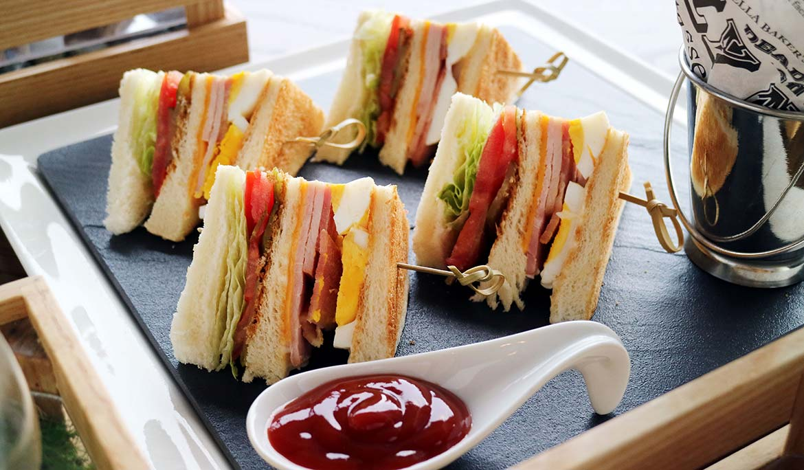 Club Sandwich with French Fries ( Bacon, Ham, Cheese, Egg, Tomato, Lettuce and Mayonnaise )